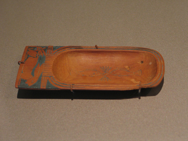 Toilet Dish in Form of Cartouche Containing Fish, ca. 1539-1292 B.C.E. Wood, frit, 2 1/8 x 4 5/8 in. (5.4 x 11.8 cm). Brooklyn Museum, Charles Edwin Wilbour Fund, 37.608E. Creative Commons-BY