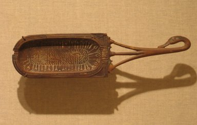 Toilet Spoon with Bowl in Shape of a Cartouche, ca. 1336-1295 B.C.E. Wood, paste, 2 3/8 x 9 3/16 in. (6 x 23.3 cm). Brooklyn Museum, Charles Edwin Wilbour Fund, 37.616E. Creative Commons-BY