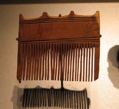 Comb Surmounted by Four Knobs, ca. 1539-1292 B.C.E. Wood, 2 7/16 x 2 7/8 in. (6.2 x 7.4 cm). Brooklyn Museum, Charles Edwin Wilbour Fund, 37.652E. Creative Commons-BY