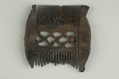 Comb with Coarse Teeth on One Side and Fine Teeth on the Other. Wood, 3 7/16 x 3 3/8 in. (8.7 x 8.6 cm). Brooklyn Museum, Charles Edwin Wilbour Fund, 37.672E. Creative Commons-BY