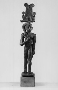 Small Statuette of Horus Wearing an Elaborate Headdress. Bronze, 5 1/16 x 1 1/8 x 1 5/8 in. (12.8 x 2.9 x 4.2 cm). Brooklyn Museum, Charles Edwin Wilbour Fund, 37.691E. Creative Commons-BY