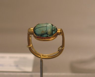 Scarab of Thutmose III Mounted in Ring, ca. 1479-1425 B.C.E. Steatite, glazed and gold, Height 1 1/16 x Length 15/16 in. (2.7 x 2.4 cm). Brooklyn Museum, Charles Edwin Wilbour Fund, 37.720E. Creative Commons-BY