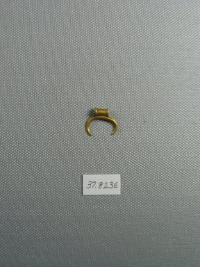 Amulet in the Form of a Crescent, 2nd-1st century B.C.E. Gold, 9/16 x 3/16 x 11/16 in. (1.5 x 0.5 x 1.7 cm, 1.35 g). Brooklyn Museum, Charles Edwin Wilbour Fund, 37.823E. Creative Commons-BY