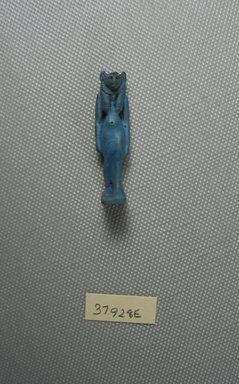 Striding Bast Figure. Faience, 1 5/8 x 7/16 x 1/2 in. (4.1 x 1.1 x 1.3 cm). Brooklyn Museum, Charles Edwin Wilbour Fund, 37.928E. Creative Commons-BY