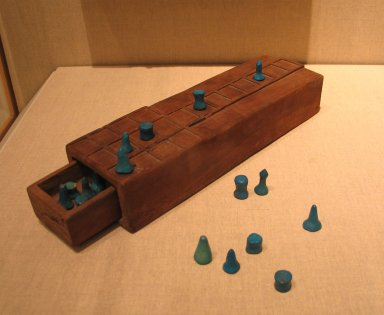 Game Board with Separate Drawer, ca. 1539-1295 B.C.E. Wood, 2 1/16 x 3 3/8 x 11 in. (5.3 x 8.5 x 28 cm). Brooklyn Museum, Charles Edwin Wilbour Fund, 37.93E. Creative Commons-BY