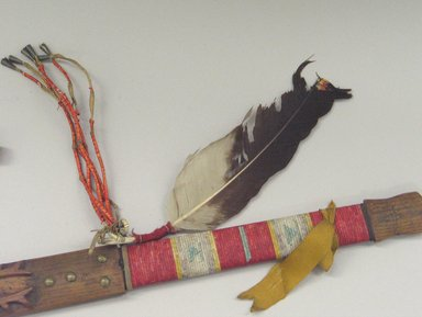 Sioux (Native American). Pipe with Carved Turtle, Buffalo, and Elk, late 19th century. Catlinite, wood, feather, tin, brass nails, porcupine quills, silk ribbon, 30 1/2 x 6 x 3 in. (77.5 x 15.2 x 7.6 cm). Brooklyn Museum, Dick S. Ramsay Fund, 38.634a-b. Creative Commons-BY