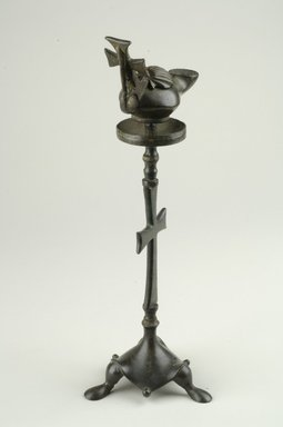 Islamic. Lamp on Separate Pricket Stand, ca. 6th century C.E. Bronze, Lamp: 3 1/2 x 2 3/4 x 6 1/8 in. (8.9 x 7 x 15.6 cm). Brooklyn Museum, Charles Edwin Wilbour Fund, 41.1086a-b. Creative Commons-BY