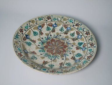 Large Plate, early 17th century. Ceramic, Kubachi ware; fritware, painted in olive green, cobalt blue and turquoise green with red and yellow slips under a transparent glaze, 2 5/16 x 13 5/8 in. (5.8 x 34.6 cm). Brooklyn Museum, Gift of Mrs. Horace O. Havemeyer, 42.212.24. Creative Commons-BY