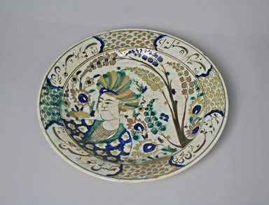 Dish Depicting Turbaned Youth and Persian Poetic Inscriptions, early 17th century. Ceramic, slip, underglaze, glaze, 13 5/8 x 2 9/16 in. (34.6 x 6.5 cm). Brooklyn Museum, Gift of Mrs. Horace O. Havemeyer, 42.212.31. Creative Commons-BY
