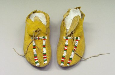 Kiowa (Native American). Pair of Woman's Moccasins, early 20th century. Deerskin, glass bead, pigment, 9 13/16 x 3 15/16 in.  (25.0 x 10.0 cm). Brooklyn Museum, Gift of Mrs. Percy Jackson, 43.156.11. Creative Commons-BY
