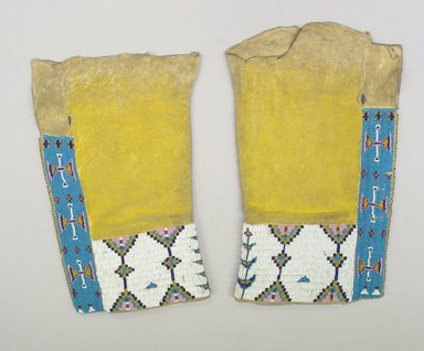 Cheyenne (Native American). Woman's Leggings, 1900-1940. Elkskin, beads, pigment, A: 16 5/16 x 9 3/4 x 1 3/8 in. (41.4 x 24.8 x 3.5 cm). Brooklyn Museum, Gift of Mrs. Percy Jackson, 43.156.2a-b. Creative Commons-BY