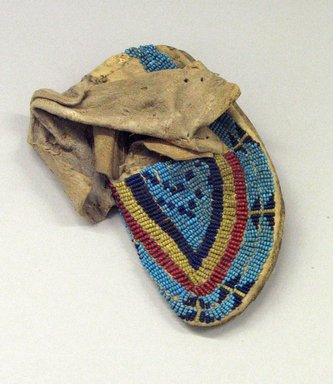 Ute (Native American). Moccasin, 1901-1933. Buckskin, beads, 5 1/2 x 2 3/8 in. (14 x 6 cm). Brooklyn Museum, Gift of Mrs. Percy Jackson, 43.156.7. Creative Commons-BY