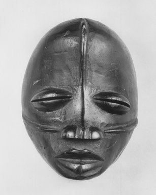 Possibly Wobe. Mask, 19th century. Wood, pigment, 5 7/8 x 4 1/2 in. (15 x 11.5 cm). Brooklyn Museum, Gift of Arthur Wiesenberger, 43.177.9. Creative Commons-BY