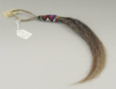 Sioux (Native American). Horsehair Pendant, early 20th century. Horsehair, hide, beads, approximate: 17 x 3/4 in. (43.2 x 1.9 cm). Brooklyn Museum, Anonymous gift in memory of Dr. Harlow Brooks, 43.201.178.1. Creative Commons-BY