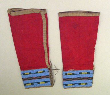 Ute (Native American). Leggings with Beaded Cuffs. Cotton cloth, hide, beads, 29 x 13 cm. Brooklyn Museum, Anonymous gift in memory of Dr. Harlow Brooks, 43.201.1a-b. Creative Commons-BY