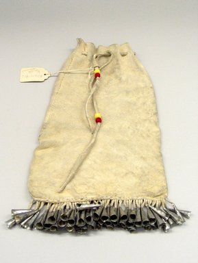 Plains (Native American). Drawstring Bag, 20th century. Buckskin, tin, beads, sinew, 11 1/2 x 6 1/2 in. (29.2 x 16.5 cm). Brooklyn Museum, Anonymous gift in memory of Dr. Harlow Brooks, 43.201.283. Creative Commons-BY
