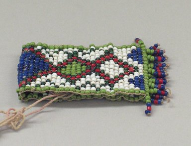 Plains (Native American). One of a Pair of Tiny, Woven, Beaded Bracelets, 20th century. Beads, 2 3/4 x 1 3/8 in. (7 x 3.5 cm). Brooklyn Museum, Anonymous gift in memory of Dr. Harlow Brooks, 43.201.58a. Creative Commons-BY