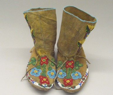 Ute (Native American). Pair of Moccasins, early 20th century. Hide, beads, metal buttons, 9 7/16 x 9 7/16 x 3 3/8 in. (24 x 24 x 8.6 cm). Brooklyn Museum, Anonymous gift in memory of Dr. Harlow Brooks, 43.201.67a-b. Creative Commons-BY