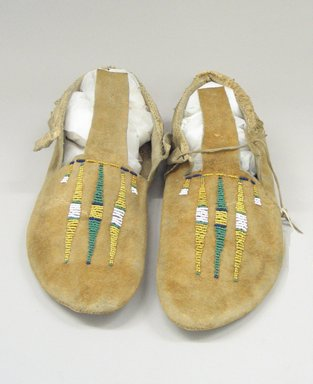 Arapaho, Northern (Native American). Pair of Moccasins, early 20th century. Hide, beads, 10 5/8 x 3 15/16 in. (27 x 10 cm). Brooklyn Museum, Anonymous gift in memory of Dr. Harlow Brooks, 43.201.70a-b. Creative Commons-BY