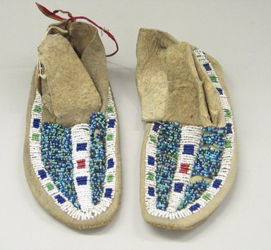 Probably Sioux (Native American). Pair of Boy's Moccasins, early 20th century. Rawhide, beads, 7 1/2 x 2 3/4 in. (19.1 x 7 cm). Brooklyn Museum, Anonymous gift in memory of Dr. Harlow Brooks, 43.201.76a-b. Creative Commons-BY