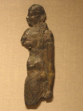Egyptian. Plaque of a Female Figure, 305-30 B.C.E. Gold-plated repousse silver, 9 5/8 x 3 1/8 in. (24.5 x 8 cm). Brooklyn Museum, Charles Edwin Wilbour Fund, 44.120. Creative Commons-BY