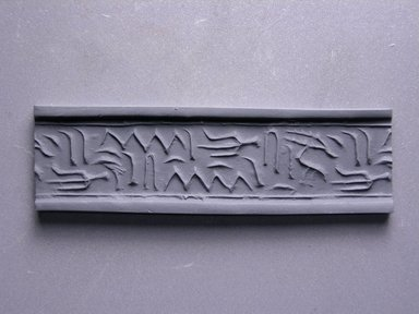 Cylinder Seal. Steatite, 11/16 x 5/8 in. (1.7 x 1.6 cm). Brooklyn Museum, Charles Edwin Wilbour Fund, 44.123.12. Creative Commons-BY