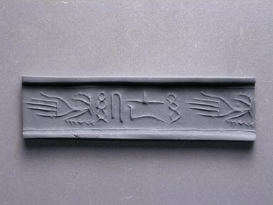 Cylinder Seal. Steatite, 1/2 x 1/2 in. (1.3 x 1.3 cm). Brooklyn Museum, Charles Edwin Wilbour Fund, 44.123.13. Creative Commons-BY