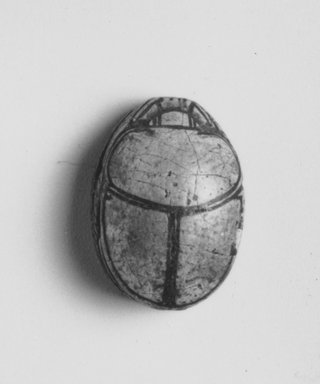 Scarab of Amunhotep I. Steatite, glazed, 1/2 x 5/8 in. (1.2 x 1.6 cm). Brooklyn Museum, Charles Edwin Wilbour Fund, 44.123.141. Creative Commons-BY