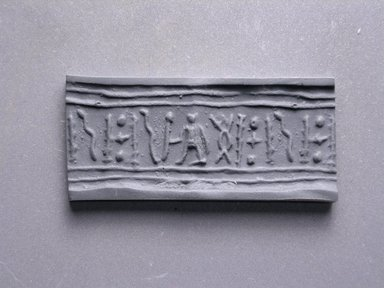 Egyptian. Cylinder Seal. Faience, glazed, 11/16 x Diam. 3/8 in. (1.8 x 0.9 cm). Brooklyn Museum, Charles Edwin Wilbour Fund, 44.123.46. Creative Commons-BY