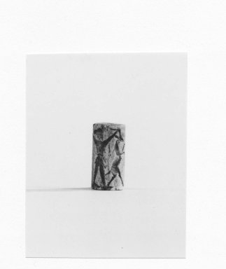 Ancient Near Eastern. Cylinder Seal, end of 2nd millennium - beginning of 1st millennium B.C.E. Bone, 13/16 x Diam. 7/16 in. (2.1 x 1.1 cm). Brooklyn Museum, Charles Edwin Wilbour Fund, 44.123.49. Creative Commons-BY