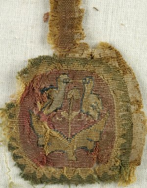 Coptic. Two Tunic Ornaments, 5th century C.E. Linen, wool, 44.143f: 1 1/2 x 4 in. (3.8 x 10.2 cm). Brooklyn Museum, Charles Edwin Wilbour Fund, 44.143f-g. Creative Commons-BY