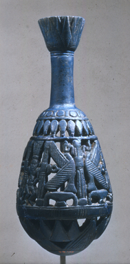 Bottle with Openwork Shell, ca. 1070-718 B.C.E. Egyptian blue, 6 11/16 x greatest diam. 2 15/16 in. (17 x 7.5 cm). Brooklyn Museum, Charles Edwin Wilbour Fund, 44.175. Creative Commons-BY