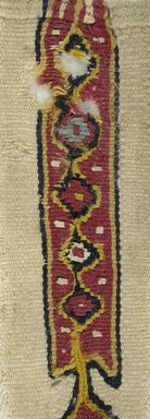 "Coptic. Tapestry Woven ""clavus,"" 7th century C.E. (probably). Linen, wool, 7 1/16 x 2 3/16 in. (18 x 5.5 cm). Brooklyn Museum, Gift of Pratt Institute, 46.157.5. Creative Commons-BY"