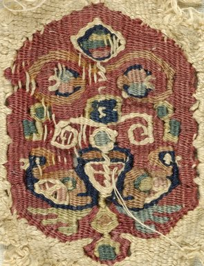 Coptic. Fragment of Linen Band with Tapestry Woven Insert, 7th Century C.E. (probably). Linen, wool, 2 3/4 x 1 11/16 in. (7 x 4.3 cm). Brooklyn Museum, Gift of Pratt Institute, 46.157.8. Creative Commons-BY