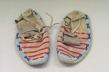 Sioux (Native American). Pair of Moccasins, 1900-1940. Beads, porcupine quills, hide, plant fibers?, 10 1/4 x 3 7/8 in. or (26.0 x 10.0 cm). Brooklyn Museum, Charles Stewart Smith Memorial Fund, 46.96.8a-b. Creative Commons-BY