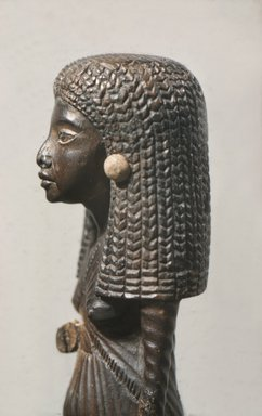 Statuette of the Lady Mi Standing, ca. 1390-1353 B.C.E. Wood, gold leaf, 6 1/8 x 1 3/4 x 2 1/4 in. (15.6 x 4.4 x 5.7 cm). Brooklyn Museum, Charles Edwin Wilbour Fund, 47.120.3. Creative Commons-BY