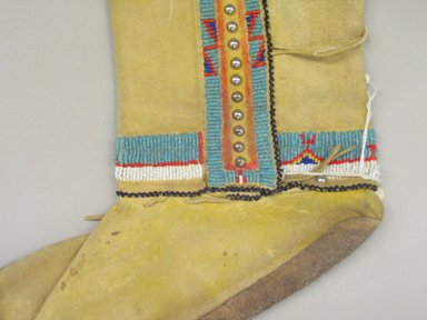Kiowa (Native American). Pair of Woman's Boots, early 20th century. Buckskin, beads, pigment, nailheads, 10 x 20 in.  (25.4 x 50.8 cm). Brooklyn Museum, By exchange, 48.116.2a-b. Creative Commons-BY