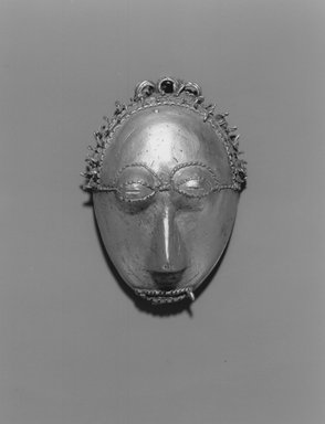 Baule. Pendant Mask, 19th or 20th century. Gold cast by the lost wax process., 2 3/8 x 1 3/4 x 1 in. (6 x 4.5 x 2.5 cm). Brooklyn Museum, A. Augustus Healy Fund, 49.32.1. Creative Commons-BY