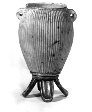 Vase of Ovoid Shape. Limestone, marble, gold, 4 3/4 x Diam. 2 1/16 in. (12.1 x 5.2 cm). Brooklyn Museum, Charles Edwin Wilbour Fund, 49.49. Creative Commons-BY