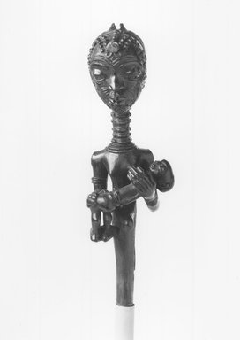 Lulua. Figure of a Mother Holding a Child  (Lupingu lwa Cibola), 19th century. Wood, copper alloy, palm oil, camwood paste, organic materials, 14 x 3 3/8 x 3 1/2 in. (35.6 x 8.6 x 8.9 cm). Brooklyn Museum, Museum Collection Fund, 50.124. Creative Commons-BY