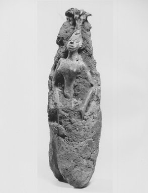 Fon. Female Figure in Investment, late 19th or early 20th century. Clay, copper alloy, 7 1/2 x 2 3/4 x 2 in. (19.0 x 6.9 x 5.1 cm). Brooklyn Museum, Museum Collection Fund, 50.125.12. Creative Commons-BY