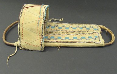 Apache (Native American). Beaded Cradleboard, 1801-1900. Wood, hide, tin, beads Brooklyn Museum, Henry L. Batterman Fund and the Frank Sherman Benson Fund, 50.67.33. Creative Commons-BY
