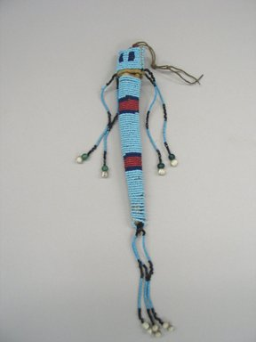 Plains, Northern (Native American). Awl Case, early 19th century. Hide, beads, 11 1/4 x 2 3/4 in. (28.6 x 7 cm). Brooklyn Museum, Henry L. Batterman Fund and the Frank Sherman Benson Fund, 50.67.36. Creative Commons-BY