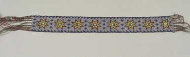 Chippewa (Native American). Garter, early 19th century. Crewel yarn, glass beads, seed beads, thread, 12 1/2 x 1 3/4 in. (31.8 x 4.4 cm). Brooklyn Museum, Henry L. Batterman Fund and the Frank Sherman Benson Fund, 50.67.37c. Creative Commons-BY