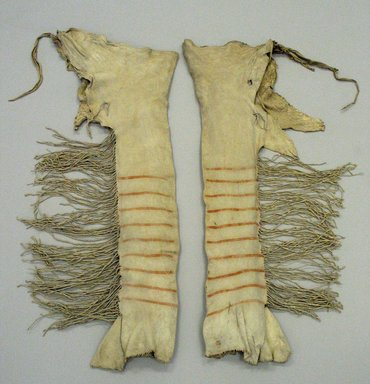 Yanktonai, Nakota, Sioux (Native American). Pair of Red and Brown Striped Leggings for Chief's Dress, early 19th century. Buckskin, pigment, sinew, Each: 37in. (94cm). Brooklyn Museum, Henry L. Batterman Fund and Frank Sherman Benson Fund, 50.67.3b-c. Creative Commons-BY