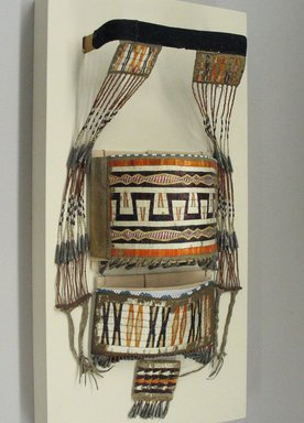 Sioux (Native American). Model Cradle Decorations, 1801-1836. Wood, hide, porcupine and bird quills, tin cones, glass beads, wool cloth, No dimensions of cradle as intact available. Brooklyn Museum, Henry L. Batterman Fund and the Frank Sherman Benson Fund, 50.67.44. Creative Commons-BY