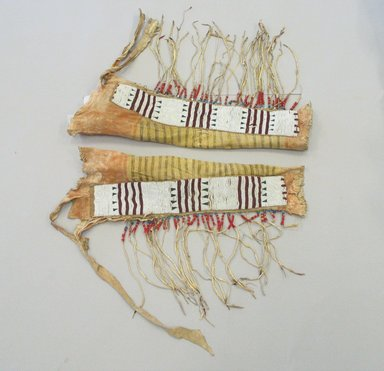 Blackfoot, Piegan (Native American). Pair of Chief's Fringed Dress Leggings, early 19th century. Hide, beads, red cloth binding,ermine fur, pigment wood Brooklyn Museum, Henry L. Batterman Fund and Frank Sherman Benson Fund, 50.67.5b-c. Creative Commons-BY