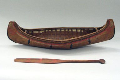 Sioux (Native American). Model of Dug-out Canoe and Paddle, early 19th century. Cedar, pigment, canoe: 7 x 26 1/8 x 4 in. (17.8 x 66.4 x 10.2 cm). Brooklyn Museum, Henry L. Batterman Fund and the Frank Sherman Benson Fund, 50.67.64a-b. Creative Commons-BY