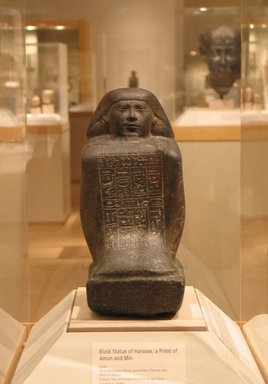 Brooklyn Museum: Squatting Statue of the Priest of Amun and Min, Harsiese