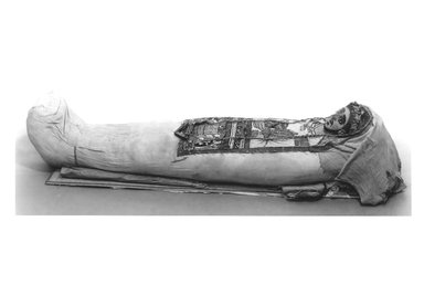 Cartonnage and Mummy, 3rd century B.C.E. Human remain, linen, plaster, paint, grass, wood, a: cartonnage: 13 1/4 x 35 7/16 in. (33.7 x 90.0 cm). Brooklyn Museum, Charles Edwin Wilbour Fund, 52.128a-e